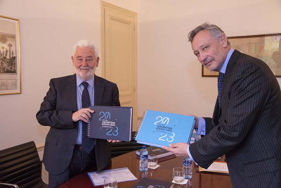 BIE Secretary General Vicente G. Loscertales receives the Expo 2023 Buenos Aires Recognition Dossier from H.E. Mario Raúl Verón Guerra, Ambassador of Argentina to France
