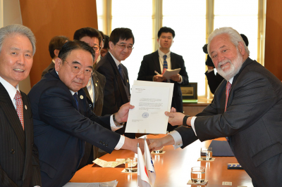 The Ambassador of Japan to France, S.E. Masato Kitera, hands the letter of candidature to the Secretary General of the BIE, Vicente G. Loscertales