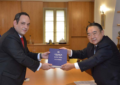 The Ambassador of Japan to France, H.E. Masato Kitera, submits the bid dossier to the Deputy Secretary General of the Bureau International des Expositions (BIE), Dimitri Kerkentzes